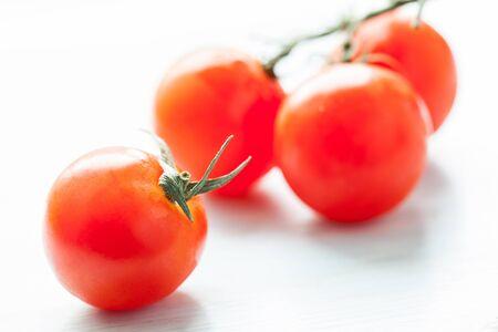 palatable: palatable fresh tomatos, neutral background