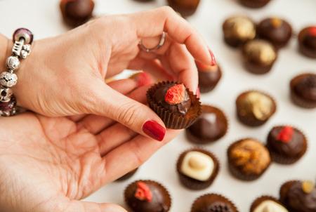 Female hand holding a truffle - closeup shot Stock Photo