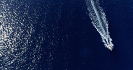 Boat at sea leaving a wake