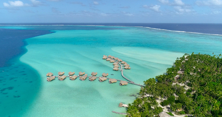 Water bungalows resort at islands, french polynesia in aerial view Stock fotó