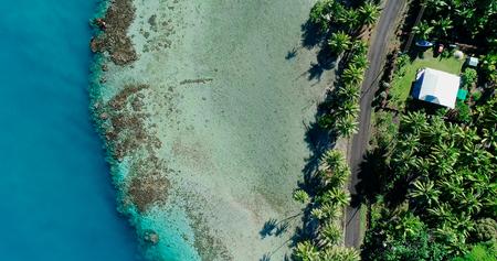 house at the edge of a lagoon, polynesia
