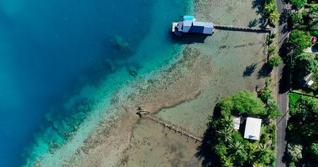 poonton and house at the edge of a lagoon, polynesia Stock Photo
