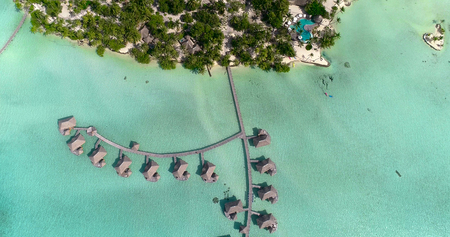 Water bungalows resort at islands, french polynesia in aerial view Stock Photo