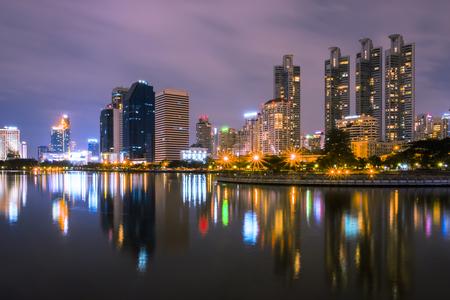 Bangkok, Thailand - December 5, 2017 : benjakiti park Landscape building at night reflects the beautiful pond