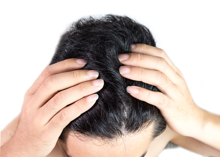 Grey hair on theyoung man head. Hair Dye Product Concept.