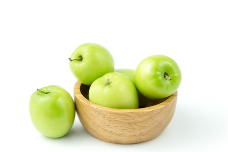 apple monkey or jujub (Zizyphus mauritiana Lam) isolated green fruit in wooden cup on white background and clipping path.