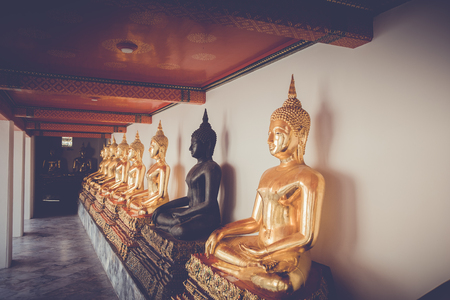 Buddha statue golden meditation in Wat Phra Chetuphon Wimonmungklaram (Wat Pho) the landmark of Bangkok, Thailand