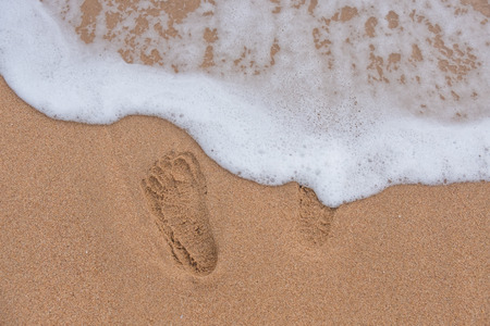 background and texture. the footprints on the sand, beach by the sea. Which is a tourist attraction in the holidays summer.