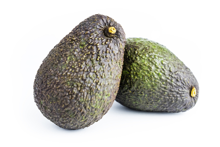 Avocado is a popular fruit in Europe and America. It has many nutrients, vitamins and minerals that are very beneficial to health. Scientific name : Persea americana Mill. isolated on white background.