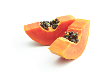 Ripe papaya is a healthy fruit. Properties as medicine. Use as a diuretic, diuretic to help heal laxative. The name is scientific : Carica papaya. isolated on white background and clipping path.