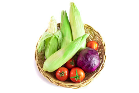 Mixed Vegetable basket of tomatoes corn and cabbage Purple, top view isolated on white background