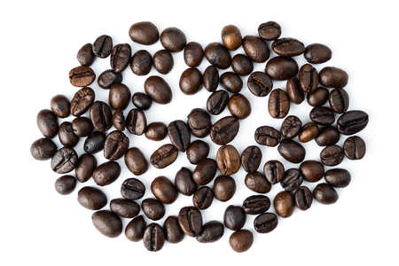 Pile of coffee beans isolated top viwe on white background.