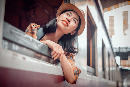 Asia young women tourists sit on the train at Hua Lamphong Station Bangkok Thailand. To Attractions on vacation.