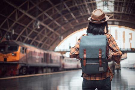 asian woman tourist traveller backpack to train station. at Hua Lamphong Station Bangkok Thailand.