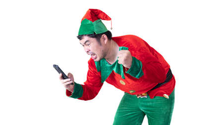 Asian men dressed as clowns He is using a smartphone to shopping online. He is happy to have a product that is pleasing and cheap. On white background and clipping path. 版權商用圖片