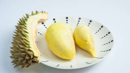 Durian in a plate on a white background and clipping path. Durian is a Thai fruit that is delicious and has a pleasant aroma.