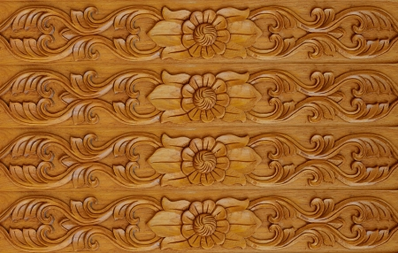 Laithai carved on the door,texture thailand photo
