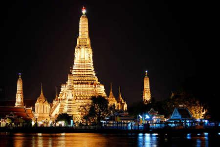 phraya: Twilight view of Wat Arun across Chao Phraya River in Bangkok at night, Thailand. Stock Photo