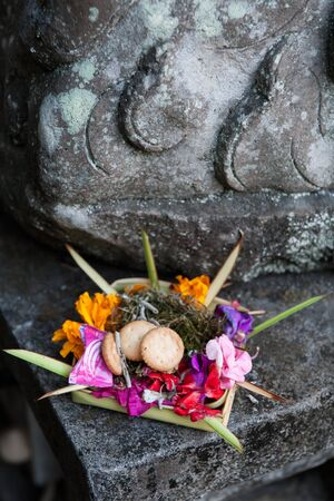 balinese: Traditional balinese offering to gods with flowers