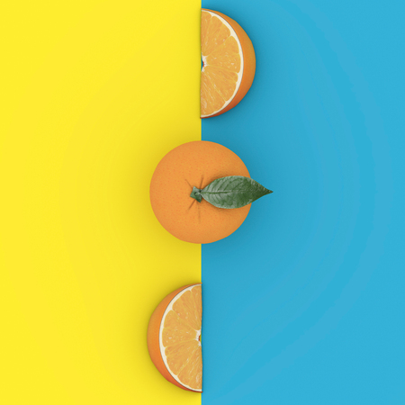 Creative Concept fruit : Outstanding Grapefruit on blue and yellow background. Minimal food concept. From top view
