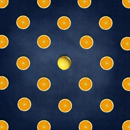 Abstract fruit : Outstanding Orange middle around half oranges on blackboard background. top view