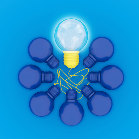 Abstract different yellow pastel Light bulbs glowing with circle shape on dark blue background, minimal concept. top view