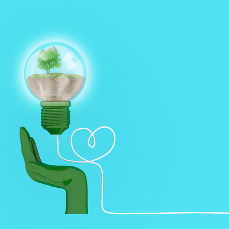 Creative concept : Light bulbs glowing with tree in hand, Environmental protection concept. minimal concept Idea. Imagens