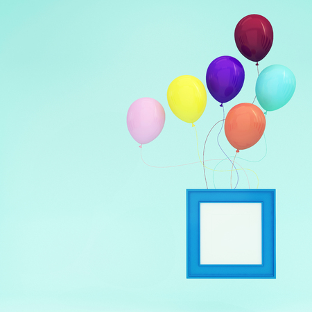 Colorful Balloons Floating with blue picture frame on light blue pastel background. minimal concept idea. photography image.