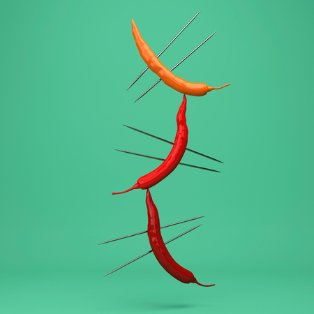 Creative Concept : Red peppers impaled floating on green background. minimal food idea concept.