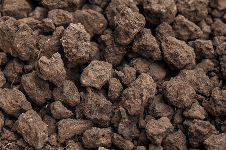 Closeup shot of Soil texture, cultivated dirt, earth, ground, brown land background. Clods of earth in a plowed field in preparation for the next planting. for use organic gardening, agriculture. Stock fotó