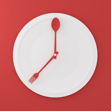 Top view of Spoon and fork on white round plate in a form of clock on red background. minimal food idea concept. Idea creative to produce work and advertising marketing communications and Websites. Reklamní fotografie
