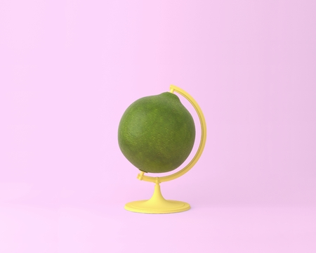 Globe sphere orb lemon, lime concepts on pastel pink background. minimal idea food and fruit concept. An idea creative to produce work within an advertising marketing communications. Business concepts