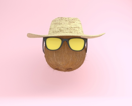 Summer times of funny attractive coconut in stylish sunglasses with hat. minimal fruit concept. Idea creative foods and drinks that are typically enjoyed at summer festivals around the world
