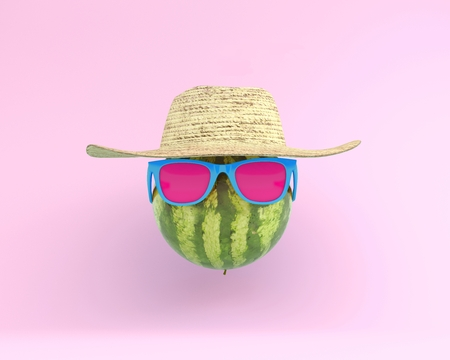 Summer times of funny attractive watermelon in stylish sunglasses with hat on pink background. minimal fruit concept. Creative idea foods and drinks that are typically enjoyed at summer festivals  Reklamní fotografie