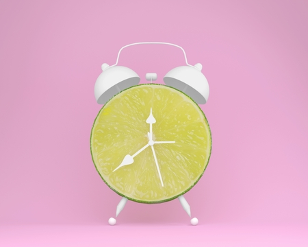 Creative idea layout fresh lime slice alarm clock on pastel pink background. minimal idea business concept. fruit idea creative to produce work within an advertising marketing communications