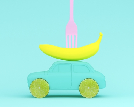 Lemon fruit layout wheel and fork, banana, car blue on pastel blue background. minimal idea food and fruit concept. Idea creative to produce work within an advertising marketing communications.