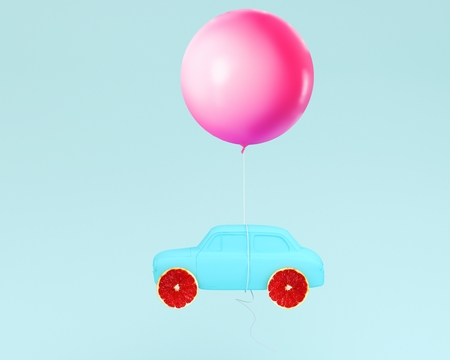 Grapefruit layout wheel and car blue with pink balloon floating on pastel blue background. minimal idea food and fruit concept. Idea creative to advertising marketing communications.