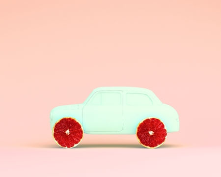 Creative grapefruit and car blue on pink color pastel background. minimal idea food and fruit concept. Stock Photo