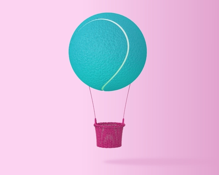 Creative idea layout blue tennis ball big hot air balloon on pastel pink background. minimal idea design sports and recreation concept. happy holiday flying balloons.