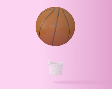 Creative idea layout Basketball big hot air balloon on pastel pink background. minimal idea design sports and recreation concept. happy holiday flying balloons. Reklamní fotografie