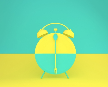 Creative layout made of spoon and fork on round plate in a form of alarm clock on yellow and green pastel background. minimal idea business concept.