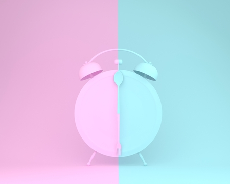 Creative layout made of spoon and fork on round plate in a form of alarm clock on pink and blue pastel background. minimal idea business concept.