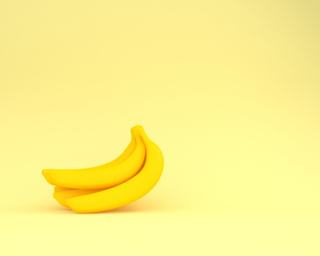Sweet banana yellow color on yellow pastel background. minimal idea food concept. An idea creative to produce work within an advertising marketing communications or artwork design. Reklamní fotografie