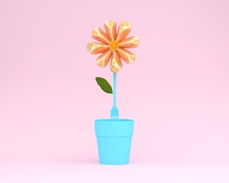 Creative layout made of orange slice flower with flowerpot on pink background. minimal idea concept.