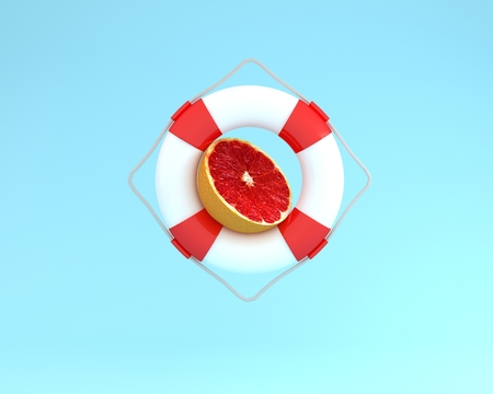 Creative summer layout made of Grapefruit slice with red pool float on blue pastel background. minimal fruit concept idea. Reklamní fotografie