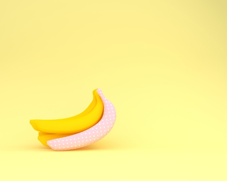 Sweet banana pink polka dots on yellow pastel background. minimal idea food concept.