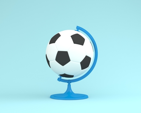 Creative idea layout football globe sphere the orb on pastel blue background. minimal idea sport concept. Idea creative to produce work within an advertising marketing communications or artwork design