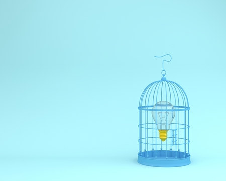 Light bulb frees an idea from a blue cage on pastel blue background wait for unlock. minimal freedom concept. Reklamní fotografie
