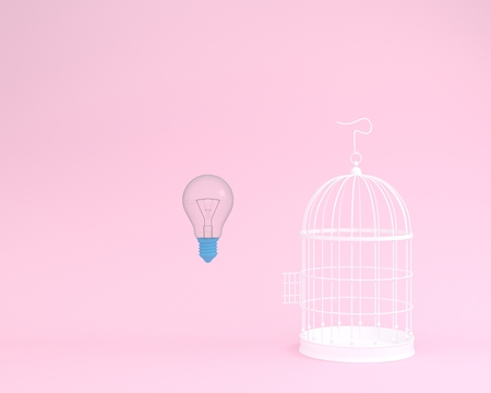 Idea light bulb flying outside a white cage on pink background. minimal freedom concept. Banque d'images