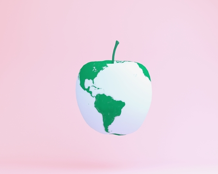 Creative layout made of apple in the form of earth globe. minimal idea food and fruit concept. An idea creative to produce work within an advertising marketing communications. Reklamní fotografie